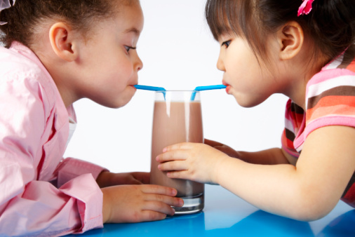 Girls Sharing Chocolate Milk